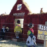 """""""Our Gang"""" makes an appearance at a kiss-hay-ing booth along the 2014 Montana Bale Trail."""