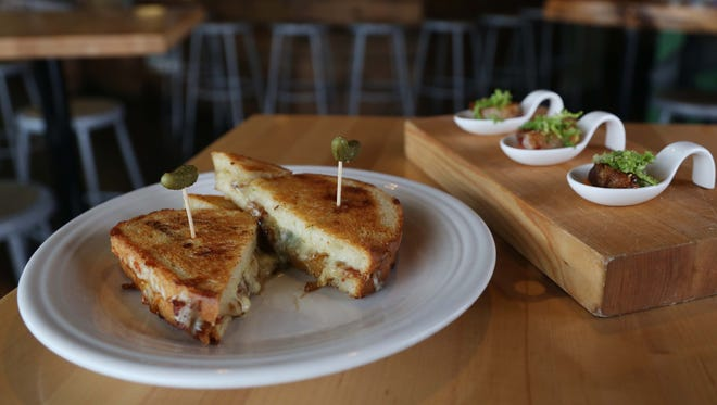 The bacon and blue toastie and BLT bites at The Cheese Shop on Thursday, Sep. 17, 2015 in Des Moines.
