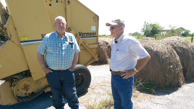 J.B. Meaux, left and Uland Guidry, right, talk about plans for the future of their respective cattle operations in Cameron Parish.  Both saw their homes and lands devastated by Hurricane Rita in 2005.  Guidry said he will rebuild, but Meaux remains skeptical of returning.  Both men now live north of the Intracoastal Canal.