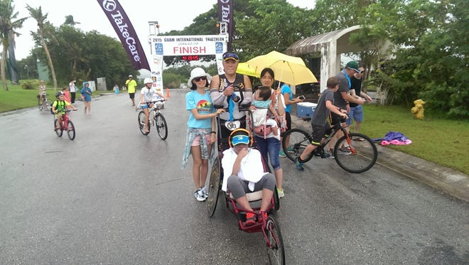 Ji Hoon Park and his son, Eun Chong, finished the 2015 Guam International Triathlon LeoPalace Cup on Sunday.