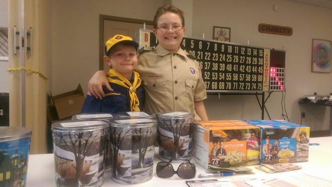 Deming Scouts, Everett Zumwalt, 7, and Lawrence Zumwalt, 11, were busy selling assorted flavors of popcorn Monday night at the Deming Elks Lodge 2750 Bingo Night. Bingo players were curious at first, but then shelled out money to purchase the popcorn that will help raise money for Troop 134 locally. Everett is Wolf Cub in the Cub Scouts rank and Lawrence is a full fledged Boy Scout.
