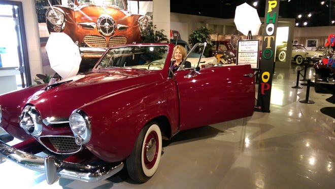 """Visitors to the Studebaker National Museum can step back in time by posing at the wheel of this 1950 Studebaker """"Bullet Nose."""""""
