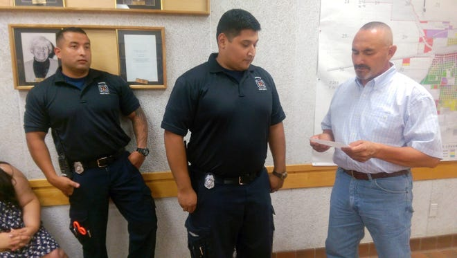 City of Deming Mayor Benny Jasso, right, administers the oath to new Deming Fire Department Firefighters, Pedro Orosco, center and Alexander Maynes during Monday's City Council meeting in the John Strand Municipal Building, 309 S. Gold St. Maynes and Orosco are now certified public servants as first responder EMTs and firefighters for the highly ranked DFD under the leadership of Fire Chief Raul Mercado. On hand for the swearing in were Lt. Kevin Hensley and Battalion Chief Heather Sosa.