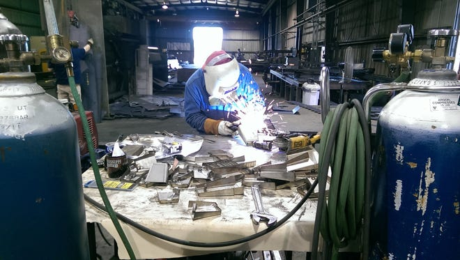 Gary Nash of the Long Beach Company applies a TIG weld to this BattleBell.