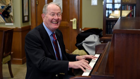 Sen. Lamar Alexander, R-Tenn., plays piano in his office