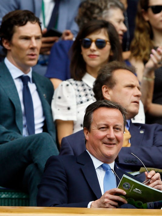 British Prime Minister David Cameron sits in the Royal Box on the fourteenth day of the Wimbledon Tennis Championships in London, Sunday, July 10, 2016. (AP Photo/Kirsty Wigglesworth)