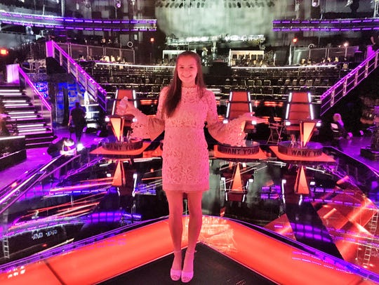 """Posing on the elaborately-lighted set of """"The Voice"""""""