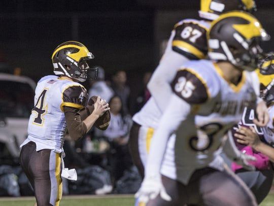 Golden West quarterback Payton Allen scans the field