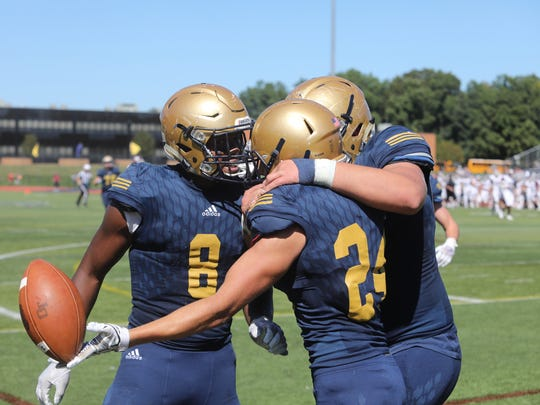 Marquez Antinori (8) with teammates Aidan Bilali (24) and Scott Essmann celebrate a second half touchdown by Bilali en route to a 35-0 win over Wayne Hills on Saturday, Sept. 23, 2017.