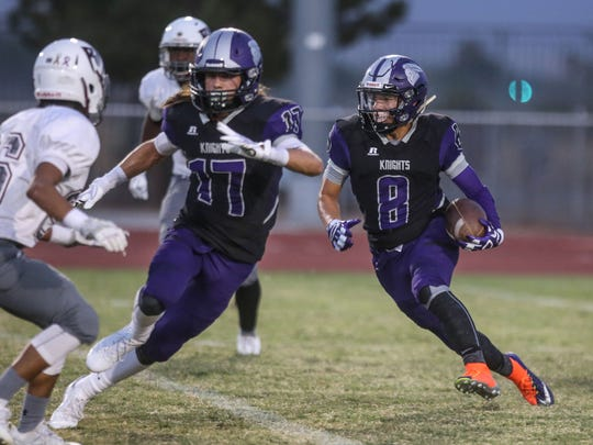 Shadow Hills Kaleb Welmas carries the ball against Rancho Mirage on Friday, September 1, 2017 in Indio.