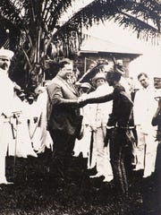 William Howard Taft, shaking hands with a Moro chieftain