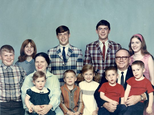 The Mayers pose for a family photo. Children in the