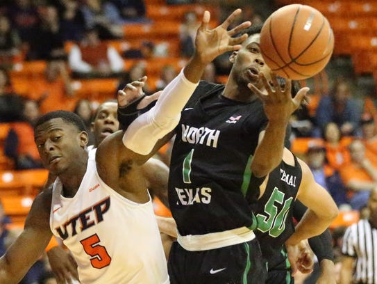 UTEP's Trey Wade, 5, fights for a loose ball with A.J.