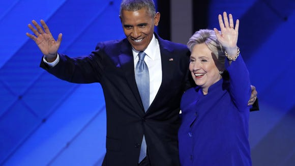President Barack Obama and Democratic presidential nominee Hillary Clinton wave to delegates after President Obama's speech during the third day of the Democratic National Convention in Philadelphia.