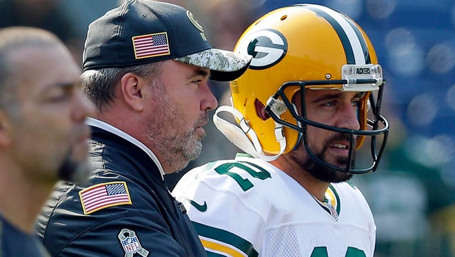 Green Bay Packers head coach Mike McCarthy talks with Green Bay Packers quarterback Aaron Rodgers (12) before the Green Bay Packers -Tennessee Titans NFL football game at Nissan Stadium in Nashville, Tennessee, Sunday, November 13, 2016.