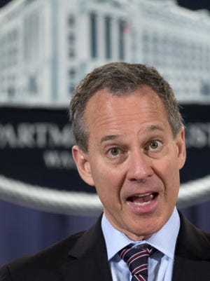 File photo of New York Attorney General Eric Schneiderman speaking at a U.S. Department of Justice news conference in 2012