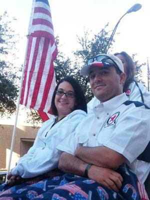 Thomas Pleyo and his wife, Keli, sit together on the parade float in Midland before it was hit by a train in November 2012.