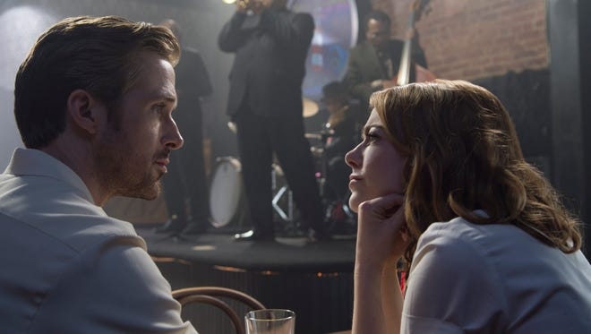 Sebastian (Ryan Gosling) and Mia (Emma Stone) fall for each other in the musical 'La La Land.'