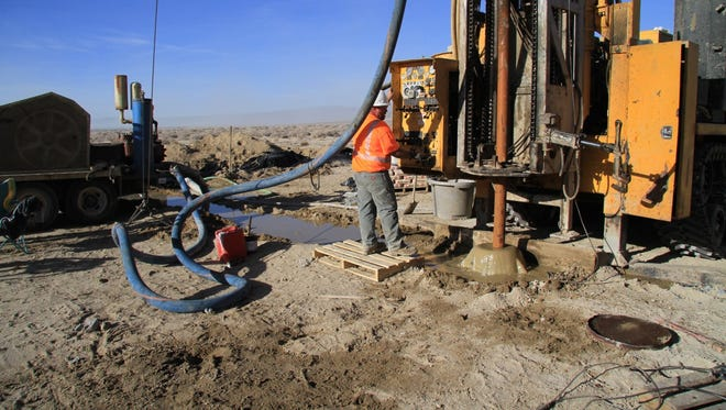 A worker operates machinery at Pure Energy Minerals' Nevada Lithium Brine Project site in Clayton Valley.
