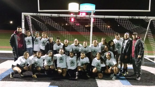 Oxnard High's girls soccer team poses after winning the Buena tournament with a 1-0 victory over Atascadero.