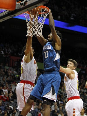 Minnesota Timberwolves guard Andrew Wiggins (22) dunks against the Atlanta Hawks in the first quarter at Philips Arena.