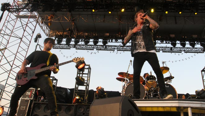 Papa Roach lead singer Jacoby Shaddix, right, and lead guitarist Jerry Horton perform at the 2015 Fort Rock at JetBlue Park.