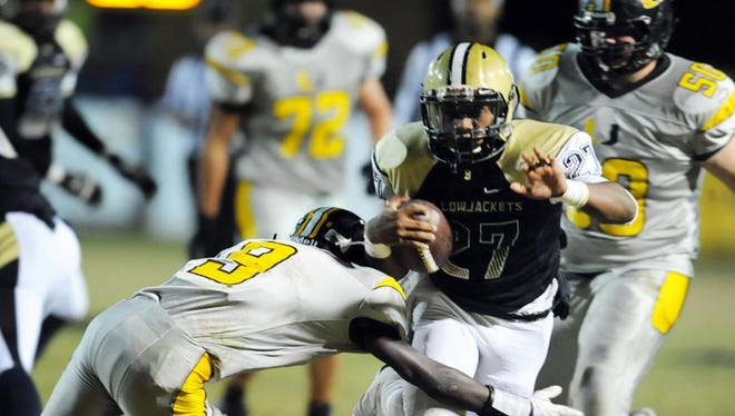Bassfield's Ron Thompson (27) runs the ball past the Union High School defense on Friday at Bassfield High School.