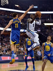 Memphis Grizzlies forward James Ennis III (8) shoots against Golden State Warriors guard Klay Thompson (11) during the second half of an NBA basketball game Saturday, Oct. 21, 2017, in Memphis, Tenn. (AP Photo/Brandon Dill)