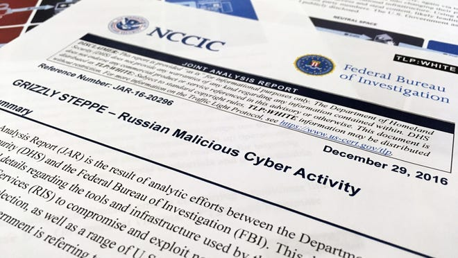 The first page of the Joint Analysis Report narrative by the Department of Homeland Security and federal Bureau of Investigation and released on Dec. 29, 2016, is photographed in Washington, Jan. 6, 2017. Computer security specialists say the technical details in the narrative that the U.S. said would show whether computers had been infiltrated by Russian intelligence services were poorly done and potentially dangerous. Cybersecurity firms ended up counseling their customers to proceed with extreme caution after a slew of false positives led back to sites such as Amazon and Yahoo Inc. Companies and organizations were following the government's advice Dec. 29 and comparing digital logs recording incoming network traffic to their computers and finding matches to a list of hundreds of internet addresses the Homeland Security Department had identified as indicators of malicious Russian intelligence services cyber activity. (AP Photo/Jon Elswick)