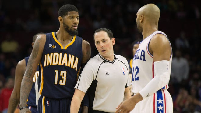 Indiana Pacers forward Paul George (13) and Philadelphia 76ers guard Gerald Henderson (12) are separated by referee Marat Kogut (32) after an altercation during the second half at Wells Fargo Center. The Pacers won 120-111.