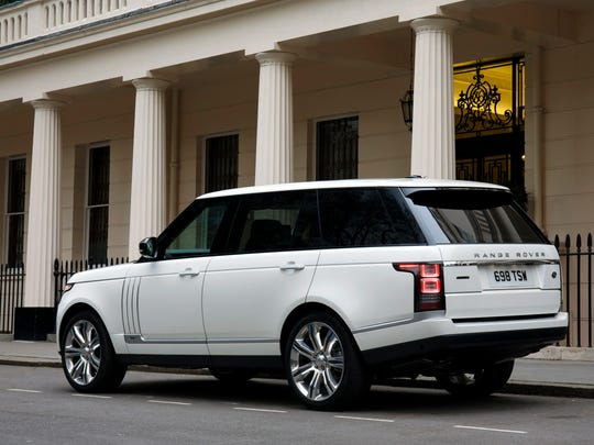 The 2014 Land Rover Range Rover LWB looks like every Range Rover before, but its aluminum-intensive body is more streamlined with rounded corners and flush glass to improve fuel economy and squelch wind noise.