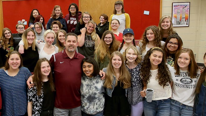 South Kitsap's Mike Allen is surrounded by his vocal students as the school year winds down.