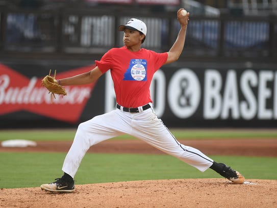 Crockett County's Peyton Freeman winds back for a pitch