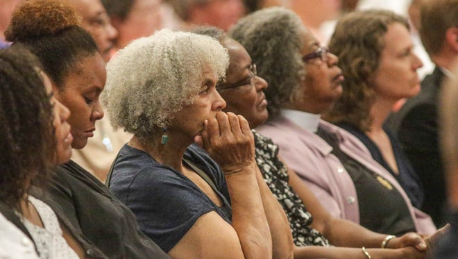 Community members listen as local leaders spoke during an interfaith community conversation at Light of the World Christian Church in Indianapolis on Saturday July 9, 2016. Various faith and community leaders held the vigil after a tragic week across the nation.
