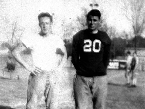Amos P. Godby (right) was one of the first coaches at Leon High School. He was hired in 1935 and won a state title in 1937, the year this photo was taken.