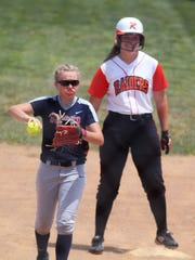 Ryle pitcher Hannah Bishop is all smiles after a first-inning