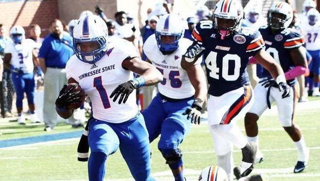 Tom Smith (1) breaks free for a 9-yard touchdown run, which gave Tennessee State a 7-0 lead on UT Martin in the first quarter Saturday.