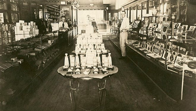 Emil H. Schultz Drug Store, 180 Main St., Menasha, is shown in this 1923 photograph. The clerk on the left is Walter Adrian. The other man is pharmacist Helmer Haugh.