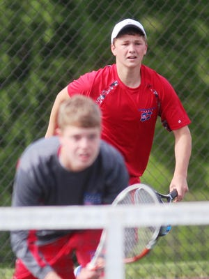 Conner's Nick Elleman and senior Nathan Eberhard won two matches in doubles at the KHSAA state tournament Thursday.