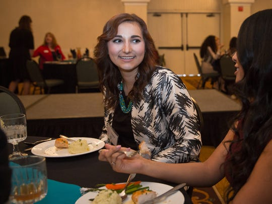 Isabelle Nankival, left, talks with Emily Enriquez during the Soroptimist International of Las Cruces' Dream It, Be It Conference at the Hotel Encanto.