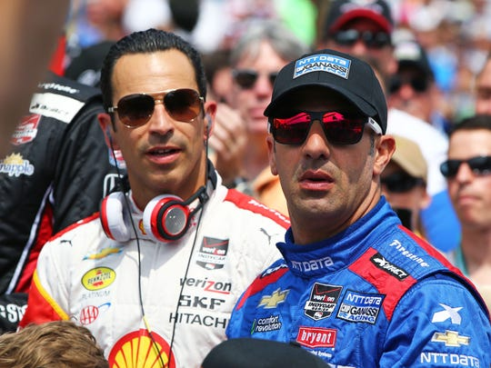 May 24, 2015; Indianapolis, IN, USA; IndyCar Series driver Tony Kanaan (right) and Helio Castroneves during the 2015 Indianapolis 500 at Indianapolis Motor Speedway. Mandatory Credit: Mark J. Rebilas-USA TODAY Sports