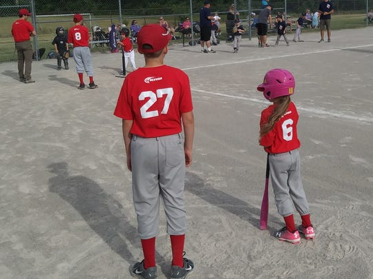 "Members of the GCYBSA 12-U Angels help coach T-ball players as they bat during the recent shadowing partnership, ""Big Angel, Little Angel."""
