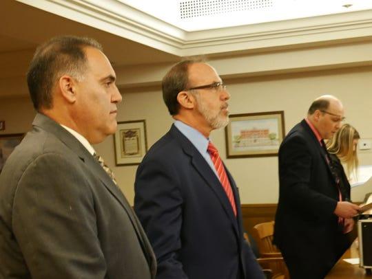 Steven Schwartz, left, stands next to his attorney