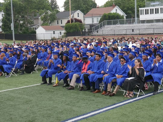 The Poughkeepsie High School class of 2018 sits on