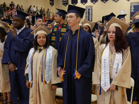 Graduating seniors from Beacon High School stand at