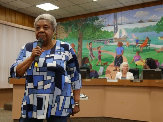 Mae Parker-Harris of Poughkeepsie addresses the crowd at a public hearing on a charter school proposal on Aug. 1, 2018.