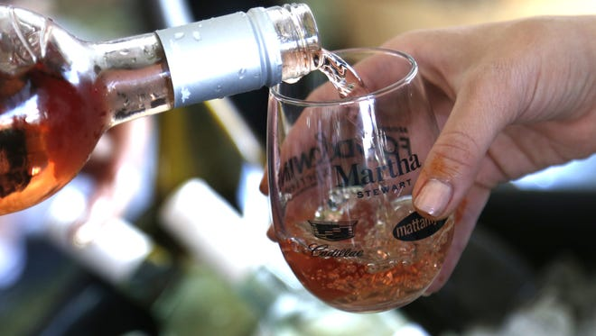 Mikala Shuping pours a glass of Noble Vines Rose at the Food and Wine Experience at the Salt River Fields at Talking Stick on November 5, 2017.