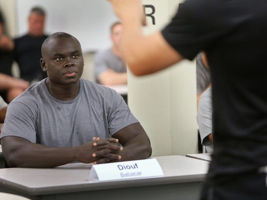 IMPD recruit Babacar Diouf listens during a class at the police academy, Thursday, June 19, 2014.