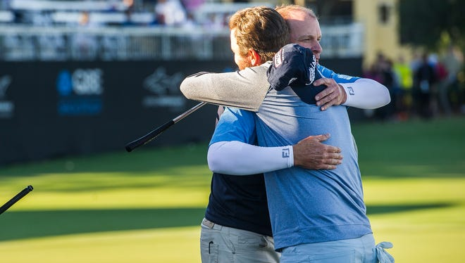 Sean O'Hair, right, and Steve Stricker hug after winning the QBE Shootout at Tiburón Golf Club in Naples on Sunday.