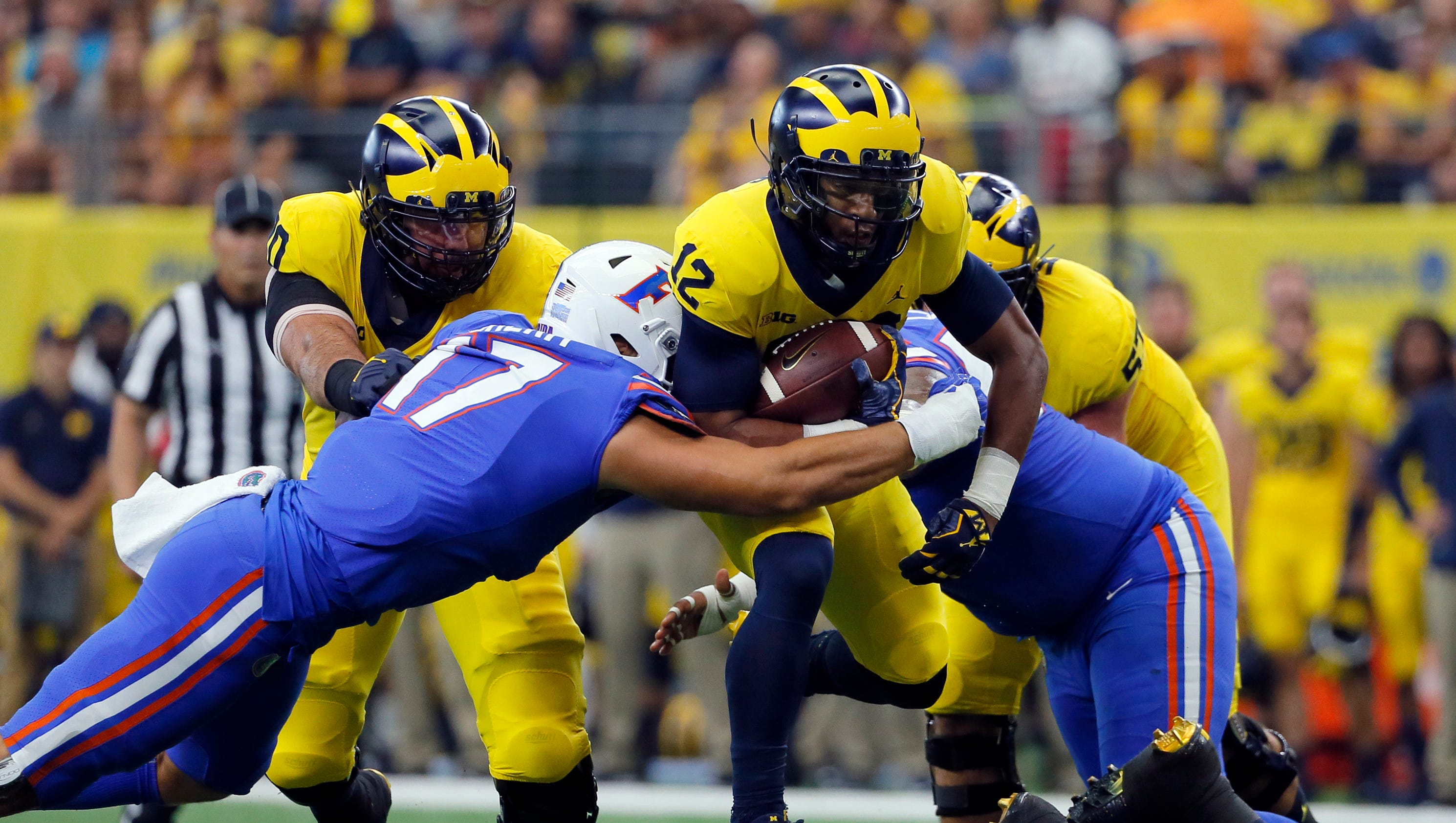 Michigan football rides relentless defense to 33-17 win ...
